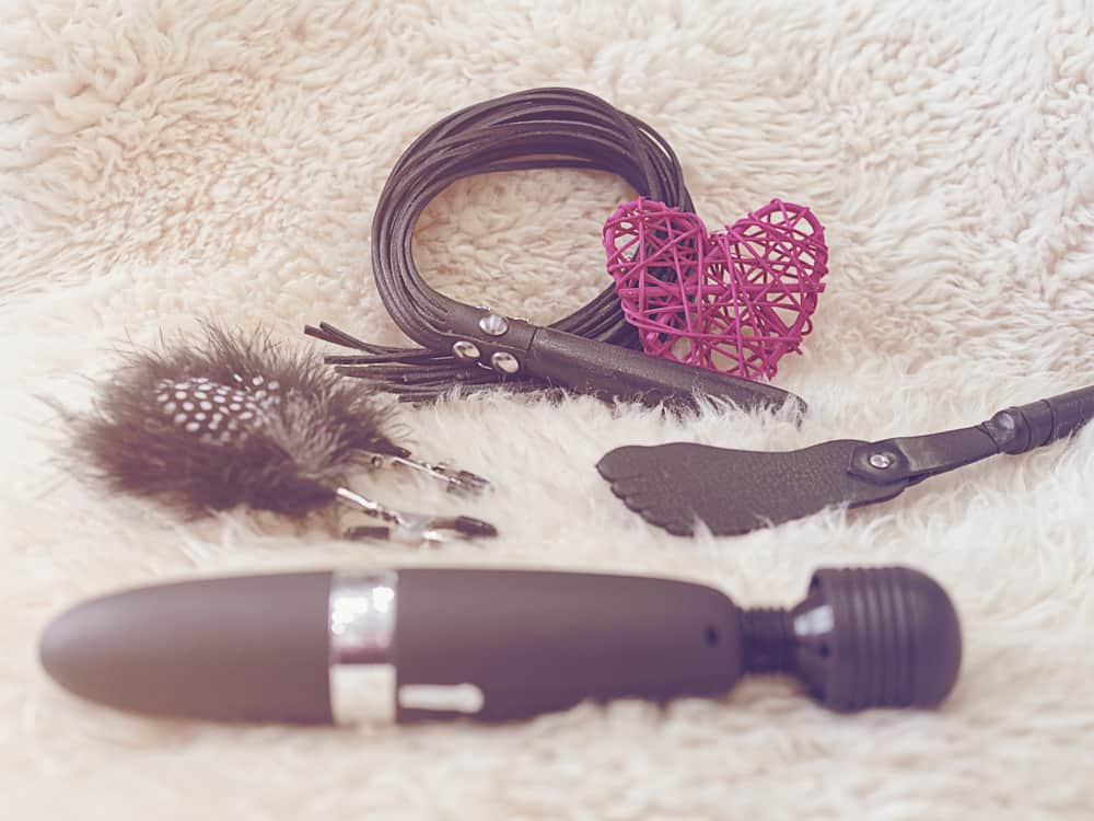 Various sex toys (leather whip, nipple clamps, wand massager