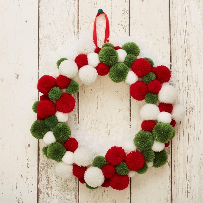 A Christmas Pom Pom Wreath