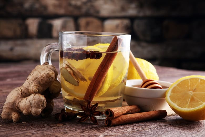 Cup of Ginger tea with lemon and honey.