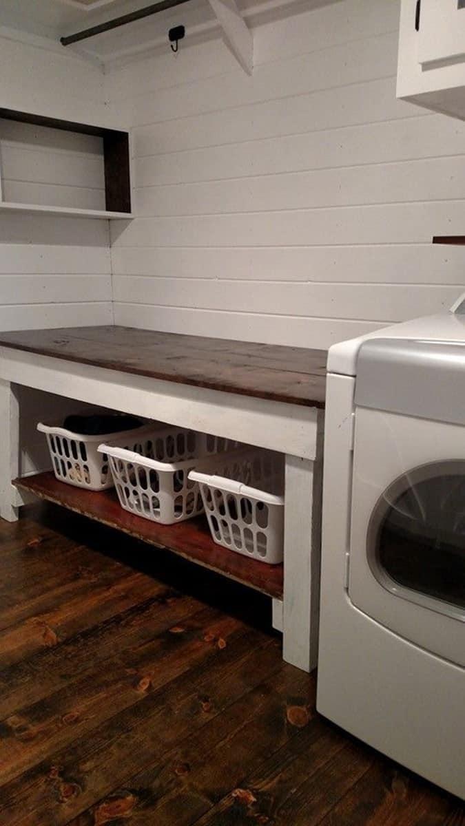 white wall that immediately makes Basement Laundry Room lighter