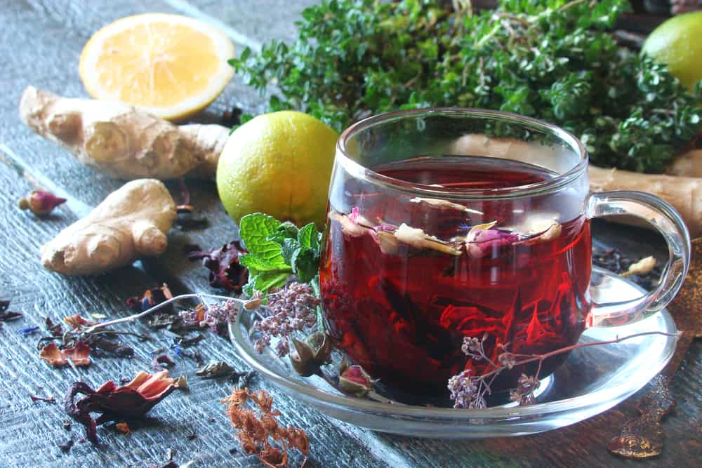 tea from herbs with ginger, lemon in a rustic style on wooden boards