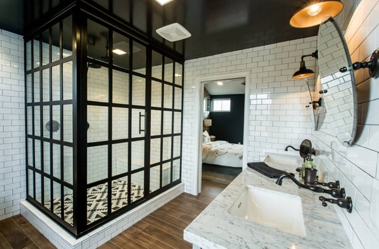 White Subway Tile Walls with a Black and White Ceramic Tile Floor